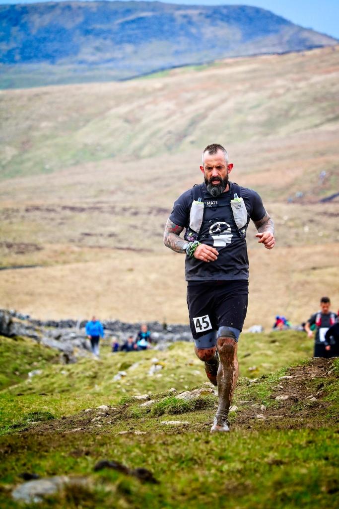 Male fell runner running in the Three Peaks Race, Yorkshire, UK by Sam Davis Professional Sports Photographer