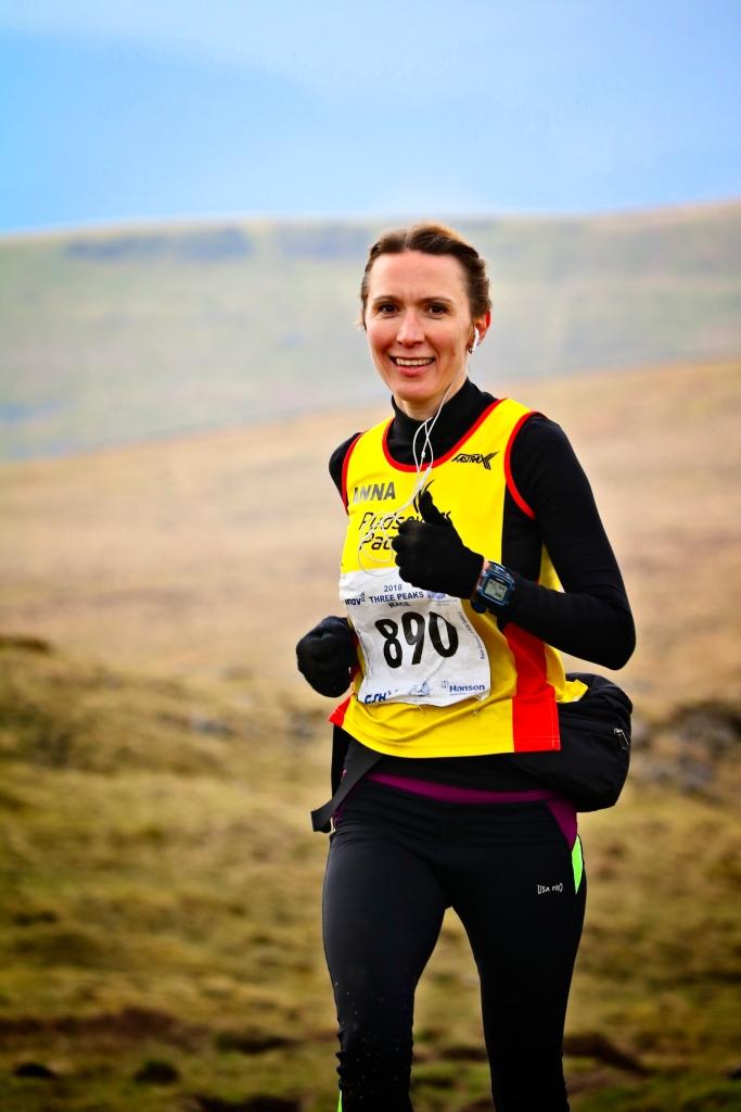 Female fell runner running in the Three peak race, Yorkshire, UK by Sam Davis Professional Sports Photographer
