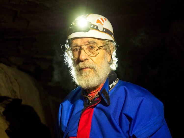 Caver Jim Davis in upper long churn by Sam Davis Photographer cave rescue mountain glasses underground speleology