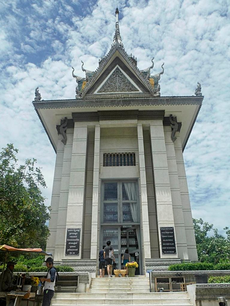 A Tower filled with human skull at the Killing Fields, Cambodia, by Sam Davis Photographer Professional Travel