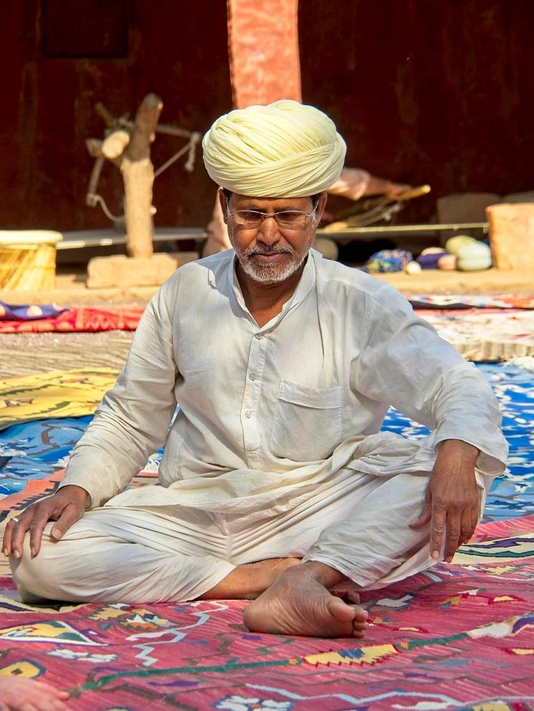 Roopraj Durry Udyog, Carpet weaver, Jodhpur, Rajasthan, India by Sam Davis Travel Portrait Photographer