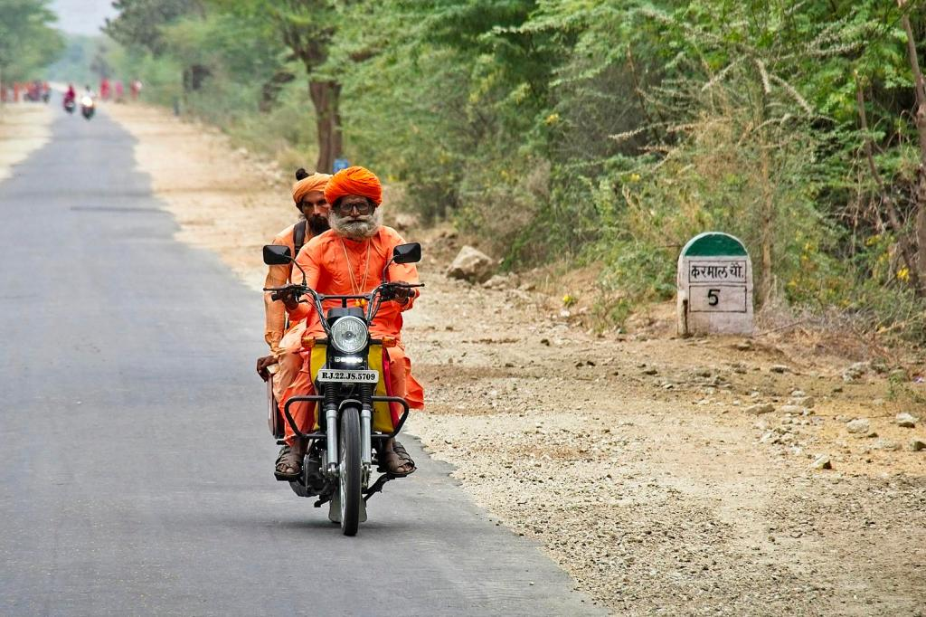 Two men in turbans on a motorcycle, Rajasthan, India by Sam Davis Travel portrait Photographer highway
