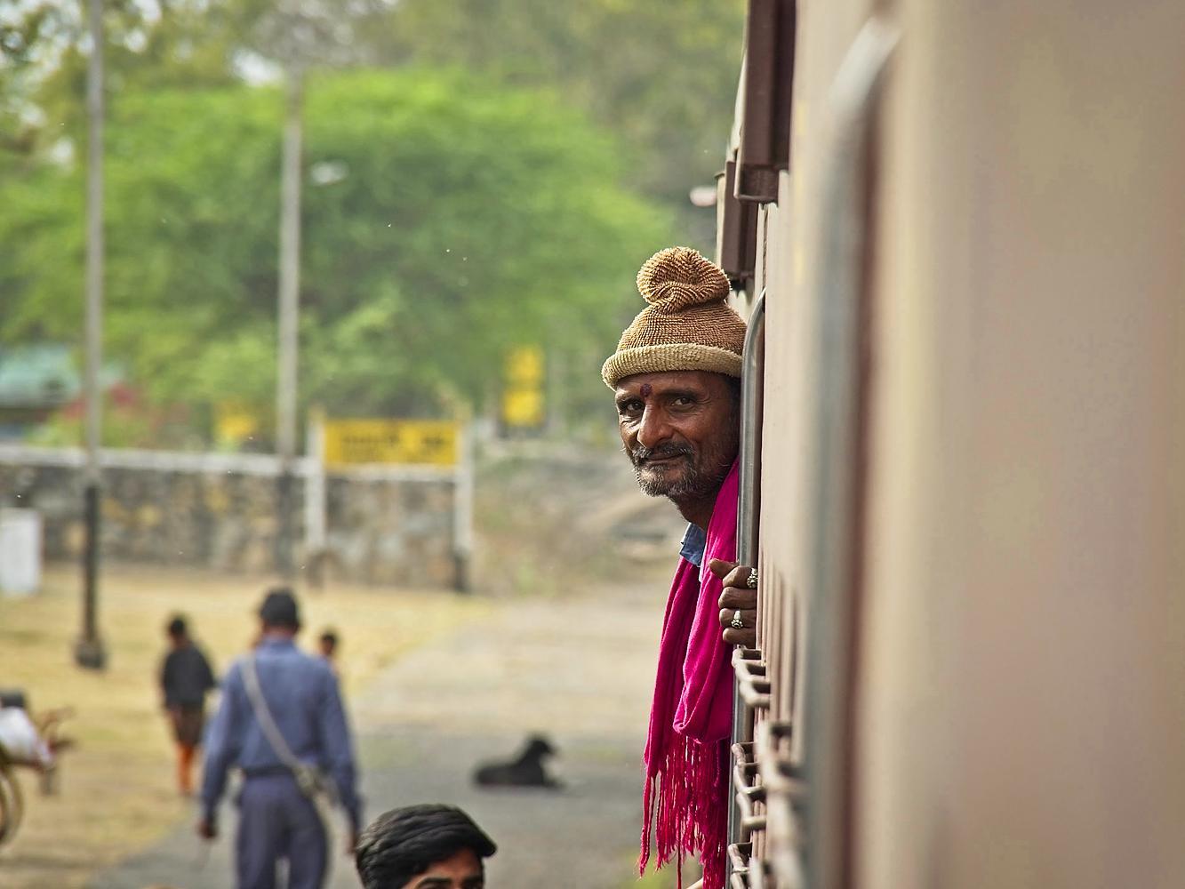 Standing on the train, Rajasthan by Sam Davis Photographer Professional travel portrait