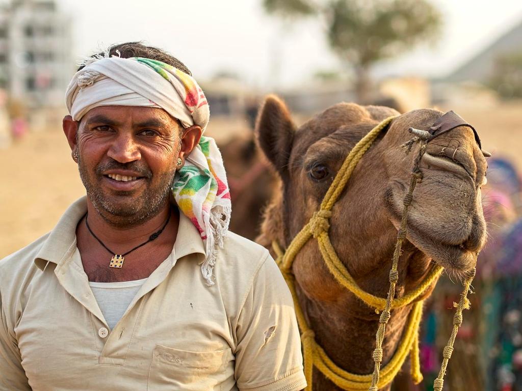 Man with his camel, Pushkar, Rajasthan, India by Sam Davis Travel Portrait Photographer