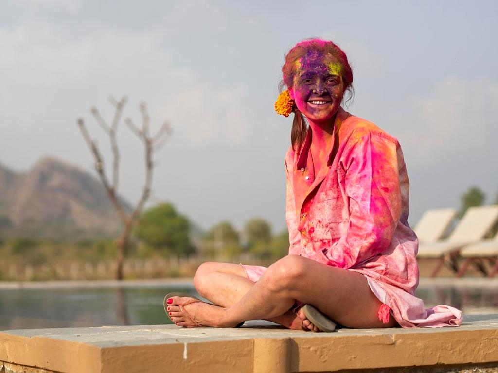 A tourist rests after Holi Festival at Camp Land's End, Pushkar, India by Sam Davis Professional Travel Portrait Photographer
