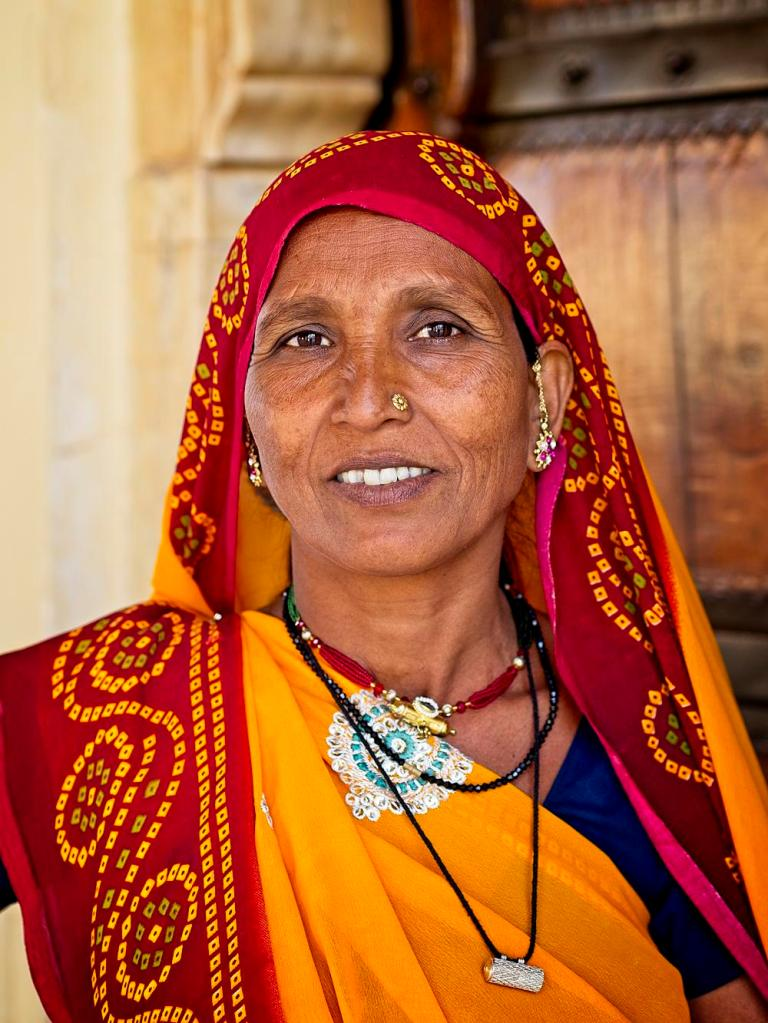 Indian lady at the Amber Palace, Jaipur, India by Sam Davis Professional Travel Portrait Photographer