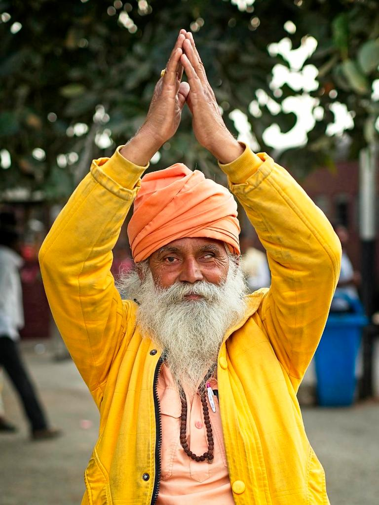 Indian Man with hands up in Turban at Train Station, Rajasthan, India by Sam Davis Professional Travel Photographer