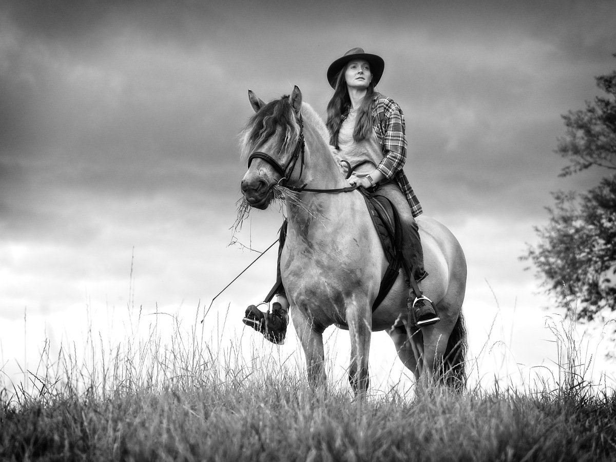 Woman on horse. Equine equestrian photo shoot prize winner
