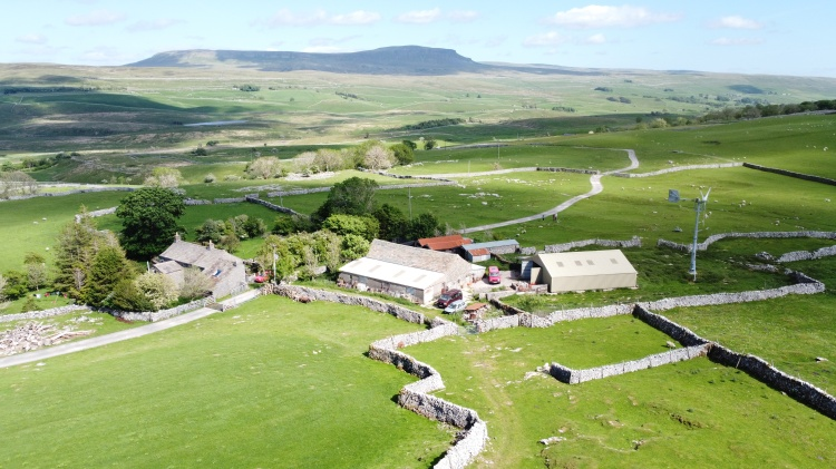 Aerial Photo of a farm in Ribblesdale, North Yorkshire, England. Aerial drone photo by Sam Davis Photographer.