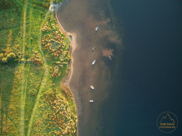 Dinghys and swimmers, Llyn Padarn, North Wales. Aerial drone photo by Sam Davis Photographer